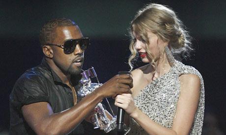 Kanye West grabs mic